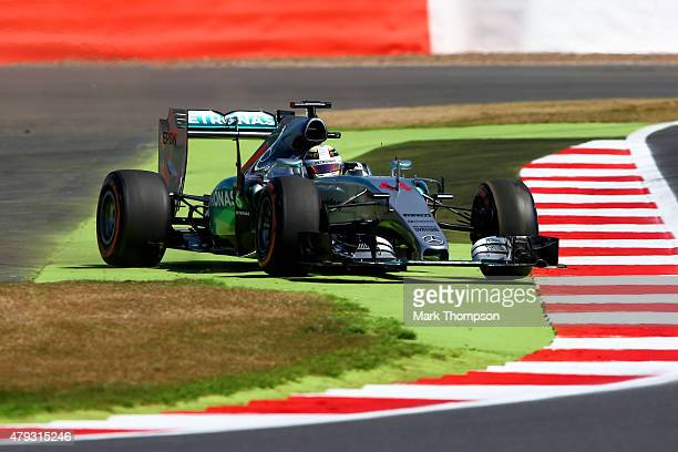 Lewis Hamilton of Great Britain and Mercedes GP runs wide during practice for the Formula One Grand Prix of Great Britain at Silverstone Circuit on...