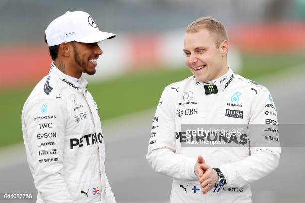 Lewis Hamilton of Great Britain and Mercedes GP shares a joke with Valtteri Bottas of Finland and Mercedes GP during the launch of the Mercedes...