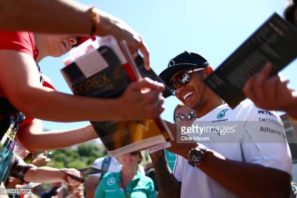 Lewis Hamilton of Great Britain and Mercedes GP signs autographs for the fans ahead of the Monaco Formula One Grand Prix at Circuit de Monaco on May...