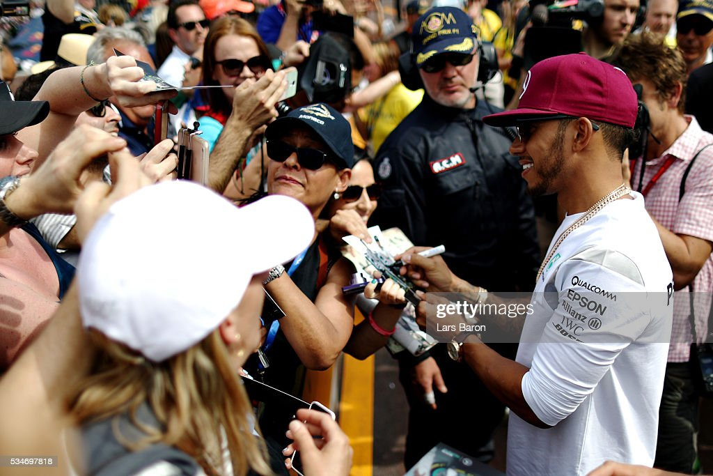 Lewis Hamilton of Great Britain and Mercedes GP signs autographs for fans during previews to the Monaco Formula One Grand Prix at Circuit de Monaco on May 27, 2016 in Monte-Carlo, Monaco.