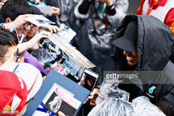 Lewis Hamilton of Great Britain and Mercedes GP signs autographs for fans during previews to the Formula One Grand Prix of China at Shanghai...
