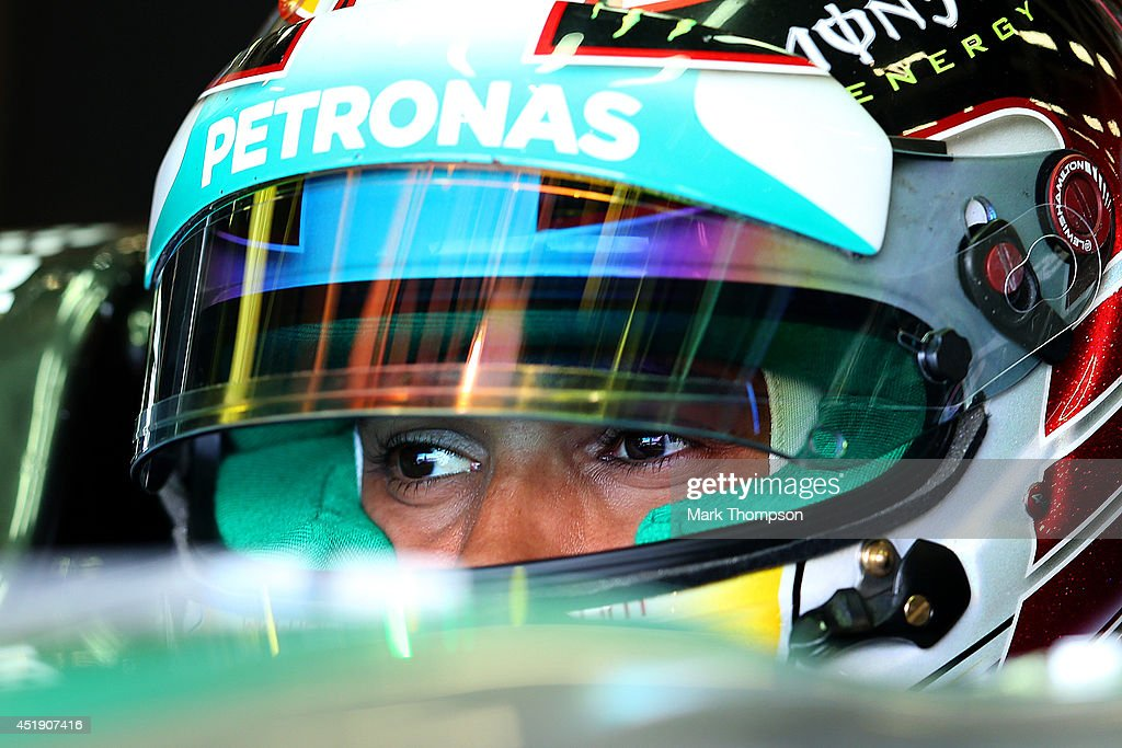 Lewis Hamilton of Great Britain and Mercedes GP sits in his car in the garage during day two of testing at Silverstone Circuit on July 9, 2014 in Northampton, England.