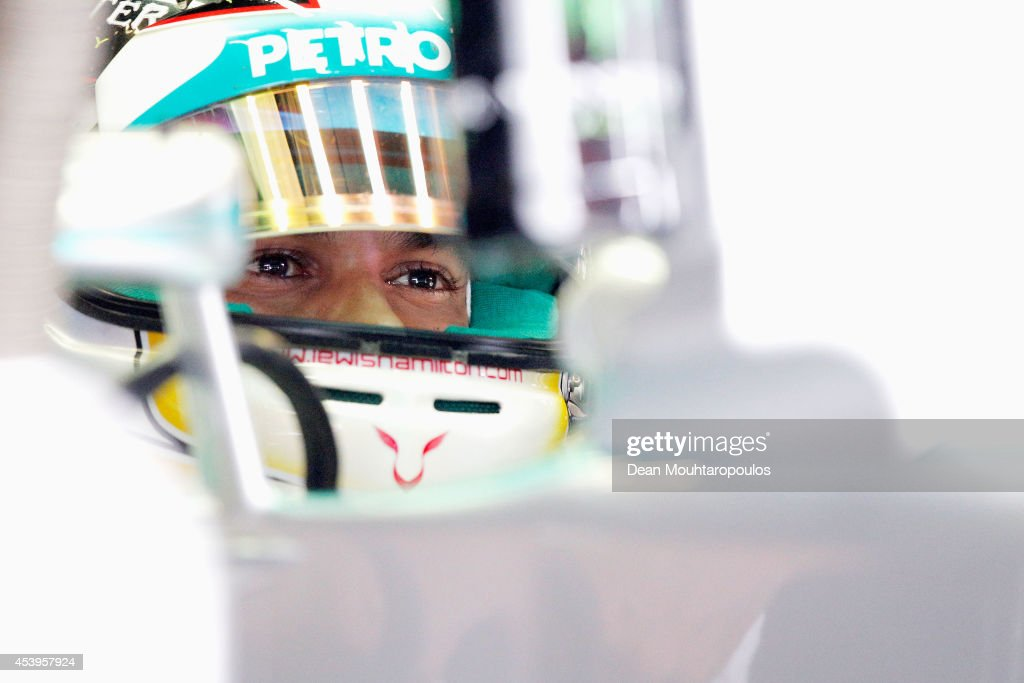 Lewis Hamilton of Great Britain and Mercedes GP sits in his car in the garage during practice ahead of the Belgian Grand Prix at Circuit de Spa-Francorchamps on August 22, 2014 in Spa, Belgium.