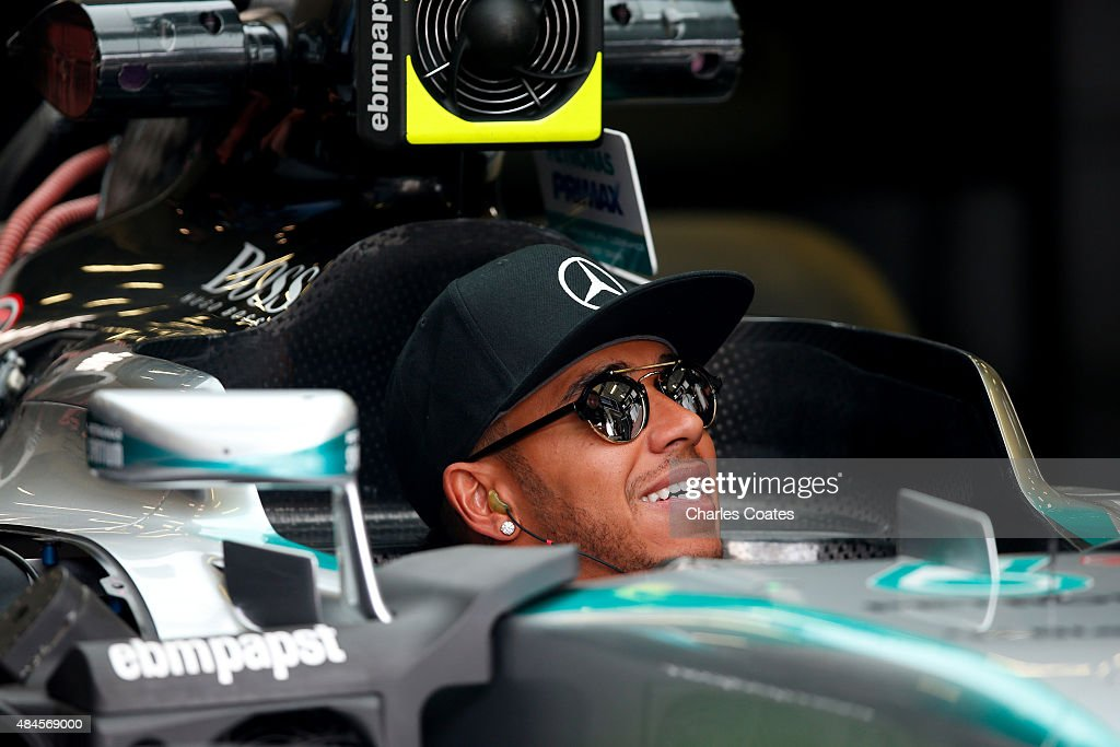 Lewis Hamilton of Great Britain and Mercedes GP sits in his car in the garage during previews to the Formula One Grand Prix of Belgium at Circuit de...
