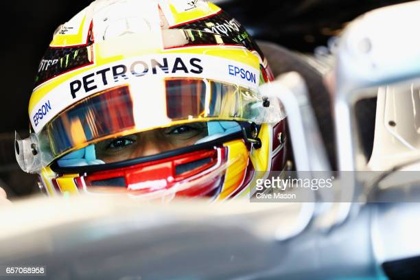 Lewis Hamilton of Great Britain and Mercedes GP sits in his car in the garage during practice for the Australian Formula One Grand Prix at Albert...