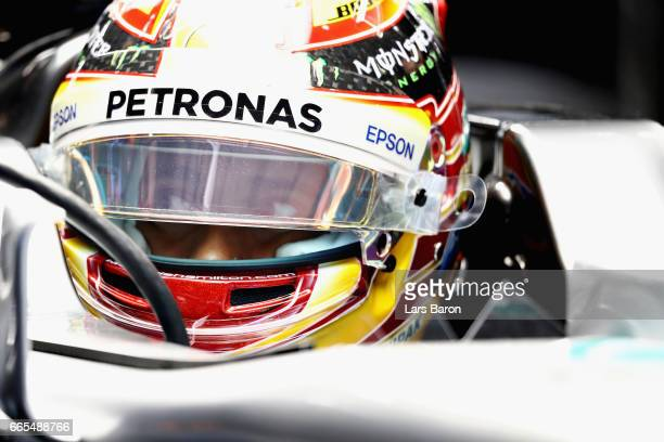 Lewis Hamilton of Great Britain and Mercedes GP sits in his car in the garage during practice for the Formula One Grand Prix of China at Shanghai...