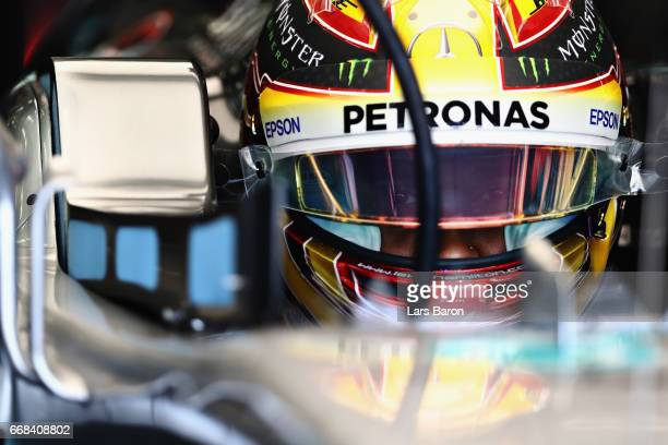 Lewis Hamilton of Great Britain and Mercedes GP sits in his car in the garage during practice for the Bahrain Formula One Grand Prix at Bahrain...