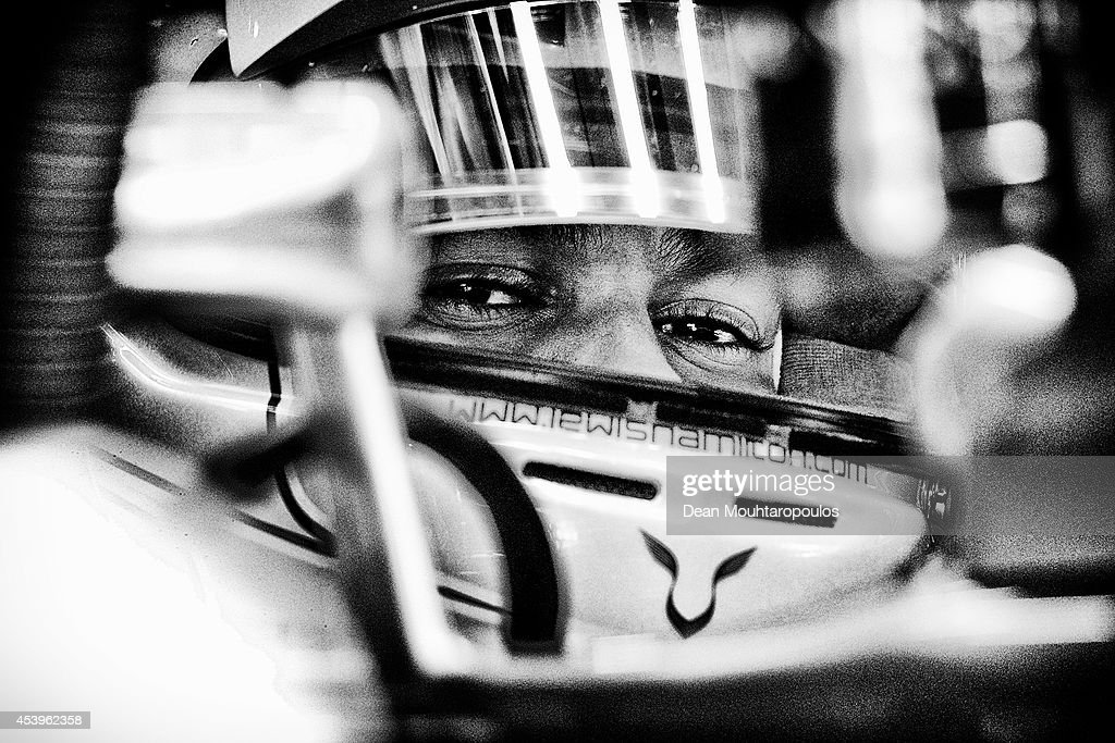 Lewis Hamilton of Great Britain and Mercedes GP sits in his car inthe garage during practice ahead of the Belgian Grand Prix at Circuit de Spa-Francorchamps on August 22, 2014 in Spa, Belgium.