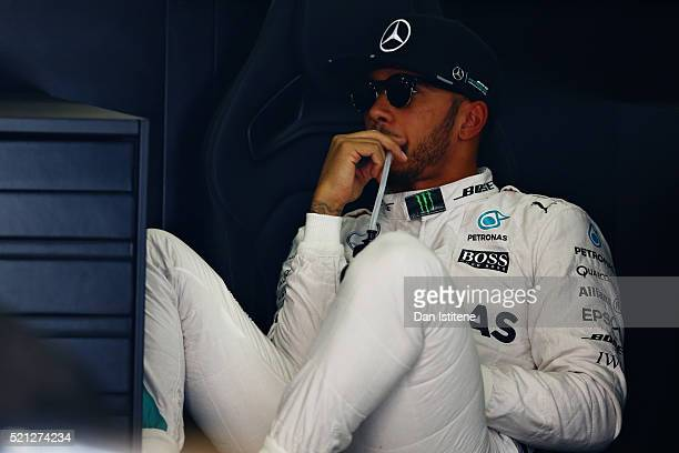Lewis Hamilton of Great Britain and Mercedes GP sits in the back of his garage during practice for the Formula One Grand Prix of China at Shanghai...