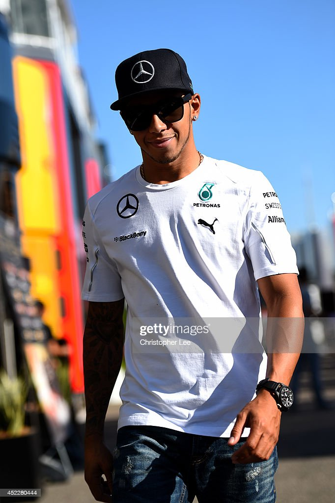 <a gi-track='captionPersonalityLinkClicked' href=/galleries/search?phrase=Lewis+Hamilton+-+Racecar+Driver&family=editorial&specificpeople=586983 ng-click='$event.stopPropagation()'>Lewis Hamilton</a> of Great Britain and Mercedes GP smiles as he walks along the paddock during previews ahead of the German Grand Prix at Hockenheimring on July 17, 2014 in Hockenheim, Germany.