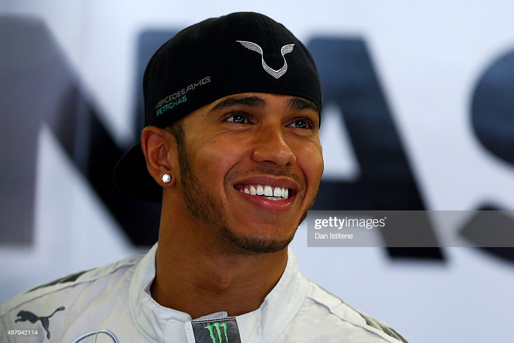 Lewis Hamilton of Great Britain and Mercedes GP smiles in the garage during final practice ahead of the Russian Formula One Grand Prix at Sochi Autodrom on October 11, 2014 in Sochi, Russia.