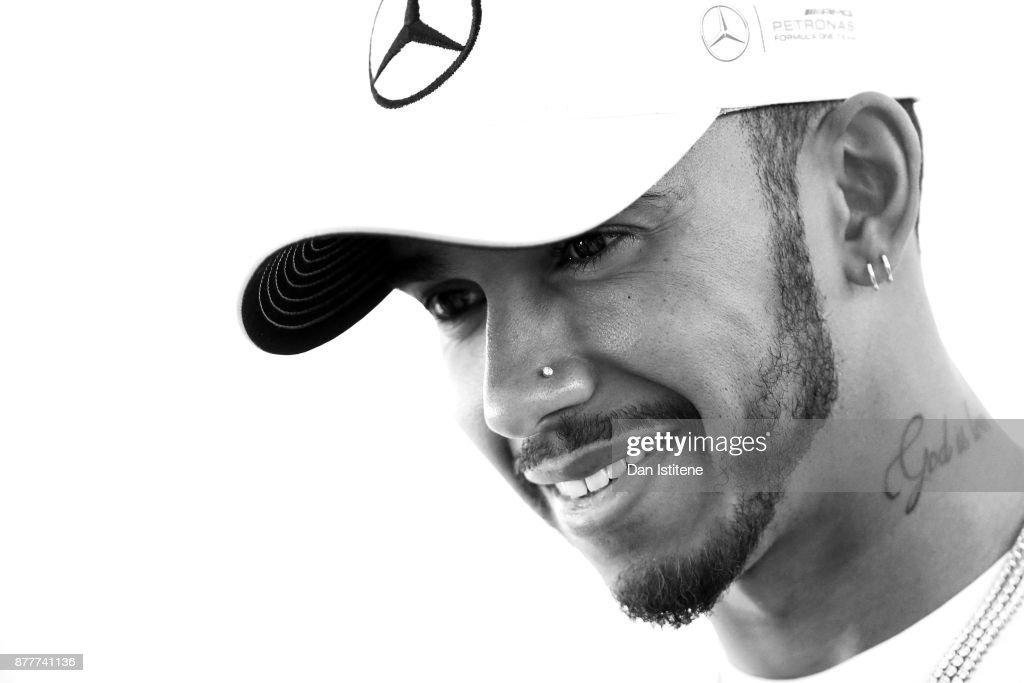 Lewis Hamilton of Great Britain and Mercedes GP smiles in the Paddock during previews for the Abu Dhabi Formula One Grand Prix at Yas Marina Circuit on November 23, 2017 in Abu Dhabi, United Arab Emirates.