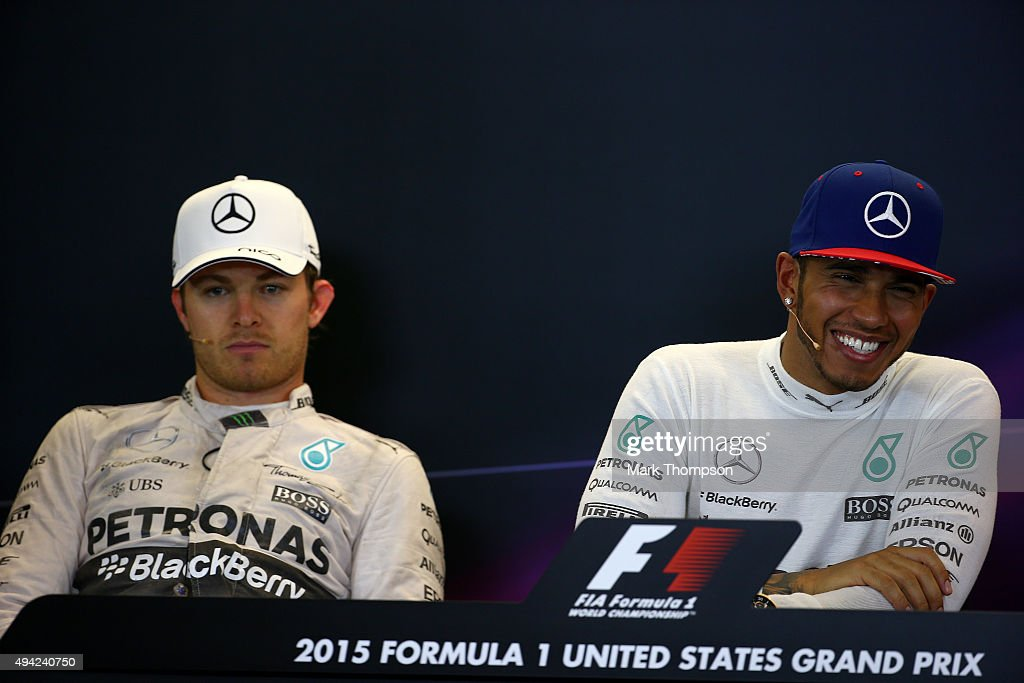 <a gi-track='captionPersonalityLinkClicked' href=/galleries/search?phrase=Lewis+Hamilton+-+Racecar+Driver&family=editorial&specificpeople=586983 ng-click='$event.stopPropagation()'>Lewis Hamilton</a> of Great Britain and Mercedes GP smiles next to a dejected <a gi-track='captionPersonalityLinkClicked' href=/galleries/search?phrase=Nico+Rosberg&family=editorial&specificpeople=800808 ng-click='$event.stopPropagation()'>Nico Rosberg</a> of Germany and Mercedes GP in a press conference after winning the United States Formula One Grand Prix and the championship at Circuit of The Americas on October 25, 2015 in Austin, United States.