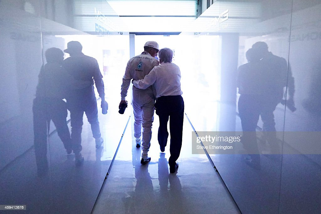 Lewis Hamilton of Great Britain and Mercedes GP speaks with F1 supremo Bernie Ecclestone during final practice ahead of the Abu Dhabi Formula One...