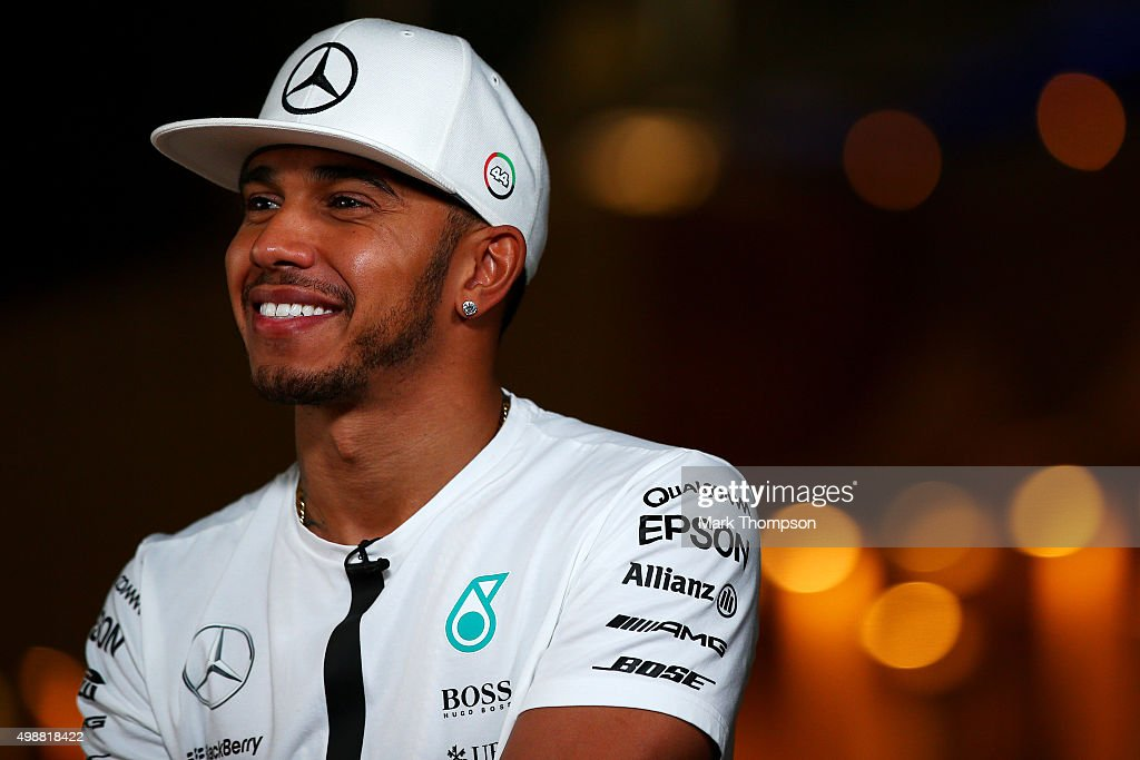 Lewis Hamilton of Great Britain and Mercedes GP speaks with members of the media in the paddock during previews for the Abu Dhabi Formula One Grand Prix at Yas Marina Circuit on November 26, 2015 in Abu Dhabi, United Arab Emirates.