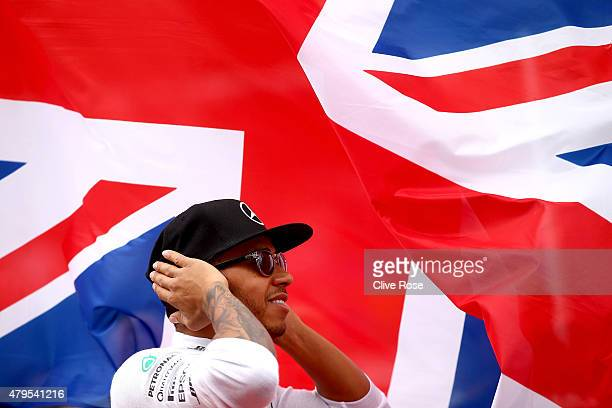 Lewis Hamilton of Great Britain and Mercedes GP stands for the national anthem before the Formula One Grand Prix of Great Britain at Silverstone...