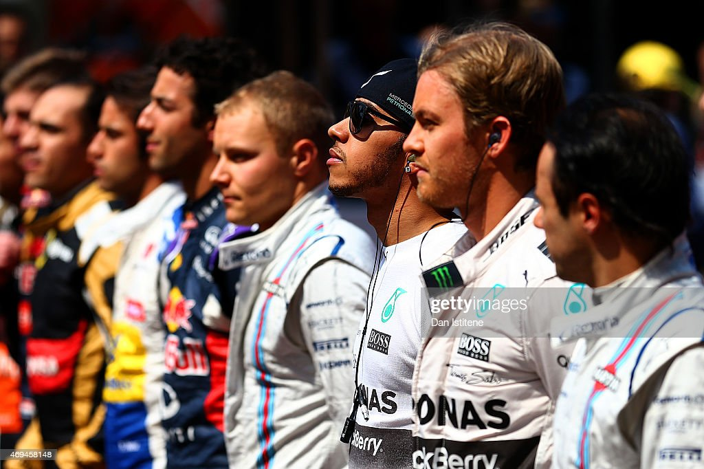 Lewis Hamilton of Great Britain and Mercedes GP stands next to his fellow drivers as the national anthem is played before the Formula One Grand Prix...