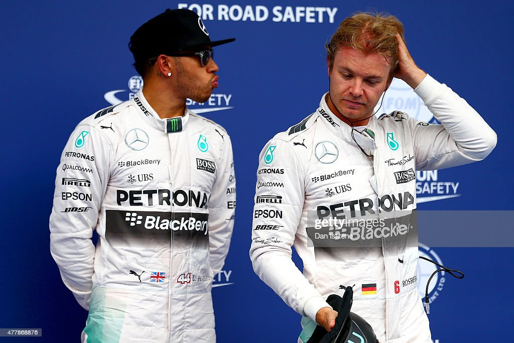 Lewis Hamilton of Great Britain and Mercedes GP stands next to Nico Rosberg of Germany in Parc Ferme after claiming pole position during qualifying...
