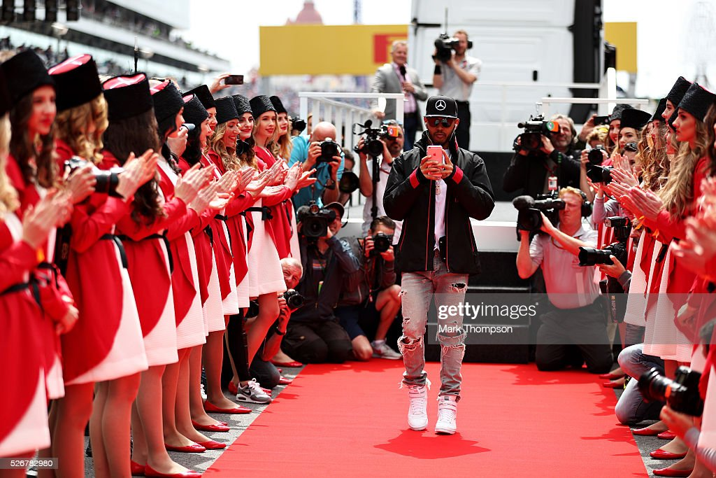 Lewis Hamilton of Great Britain and Mercedes GP takes a photo before the drivers parade ahead of the Formula One Grand Prix of Russia at Sochi Autodrom on May 1, 2016 in Sochi, Russia.