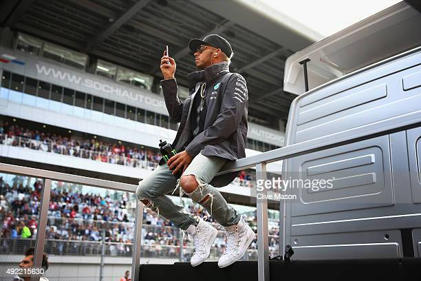 Lewis Hamilton of Great Britain and Mercedes GP takes part in the drivers' parade before the Formula One Grand Prix of Russia at Sochi Autodrom on...