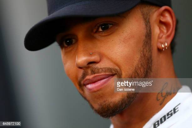 Lewis Hamilton of Great Britain and Mercedes GP talks to the media during day one of Formula One winter testing at Circuit de Catalunya on February...