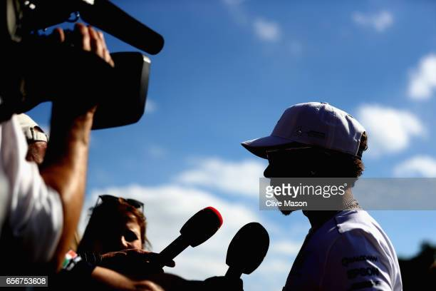 Lewis Hamilton of Great Britain and Mercedes GP talks to the media during previews to the Australian Formula One Grand Prix at Albert Park on March...