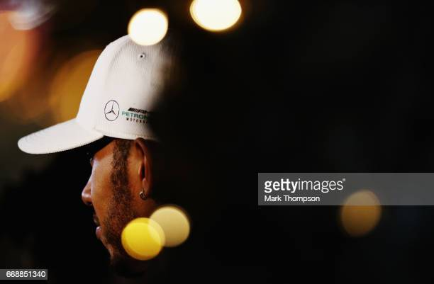 Lewis Hamilton of Great Britain and Mercedes GP talks to the media after qualifying for the Bahrain Formula One Grand Prix at Bahrain International...
