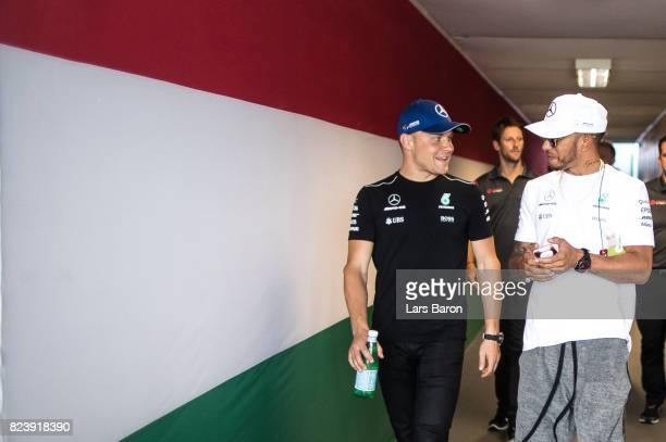Lewis Hamilton of Great Britain and Mercedes GP talks with Valtteri Bottas of Finland and Mercedes GP after practice for the Formula One Grand Prix...