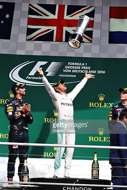 Lewis Hamilton of Great Britain and Mercedes GP throws his trophy in the air on the podium during the Formula One Grand Prix of Germany at...