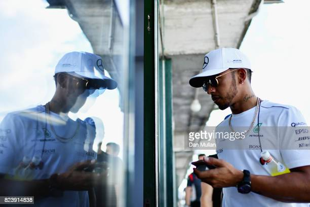 Lewis Hamilton of Great Britain and Mercedes GP walks after practice for the Formula One Grand Prix of Hungary at Hungaroring on July 28 2017 in...