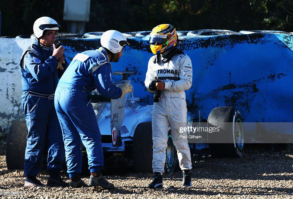 <a gi-track='captionPersonalityLinkClicked' href=/galleries/search?phrase=Lewis+Hamilton+-+Racecar+Driver&family=editorial&specificpeople=586983 ng-click='$event.stopPropagation()'>Lewis Hamilton</a> of Great Britain and Mercedes GP walks away from his car after crashing into the gravel at turn six during Formula One winter testing at Circuito de Jerez on February 6, 2013 in Jerez de la Frontera, Spain.