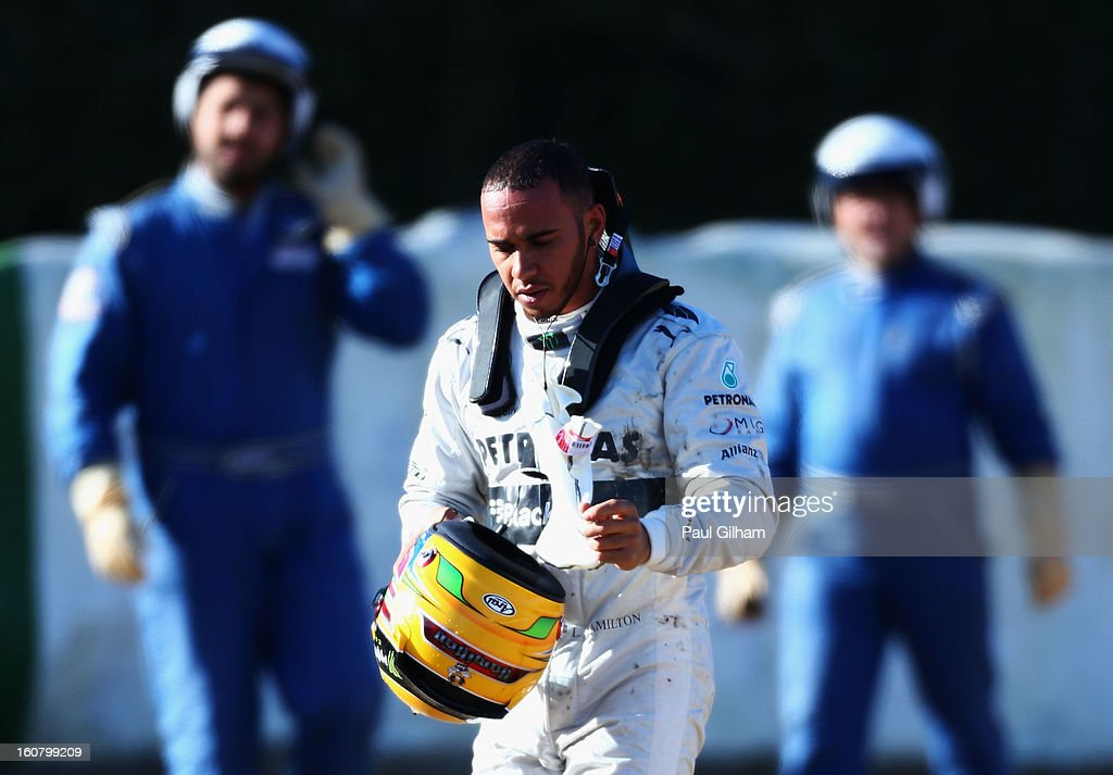 Lewis Hamilton of Great Britain and Mercedes GP walks away from his car after crashing into the gravel at turn six during Formula One winter testing at Circuito de Jerez on February 6, 2013 in Jerez de la Frontera, Spain.