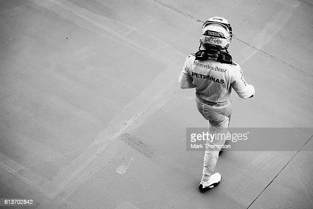 Lewis Hamilton of Great Britain and Mercedes GP walks in parc ferme after finishing third in the Formula One Grand Prix of Japan at Suzuka Circuit on...