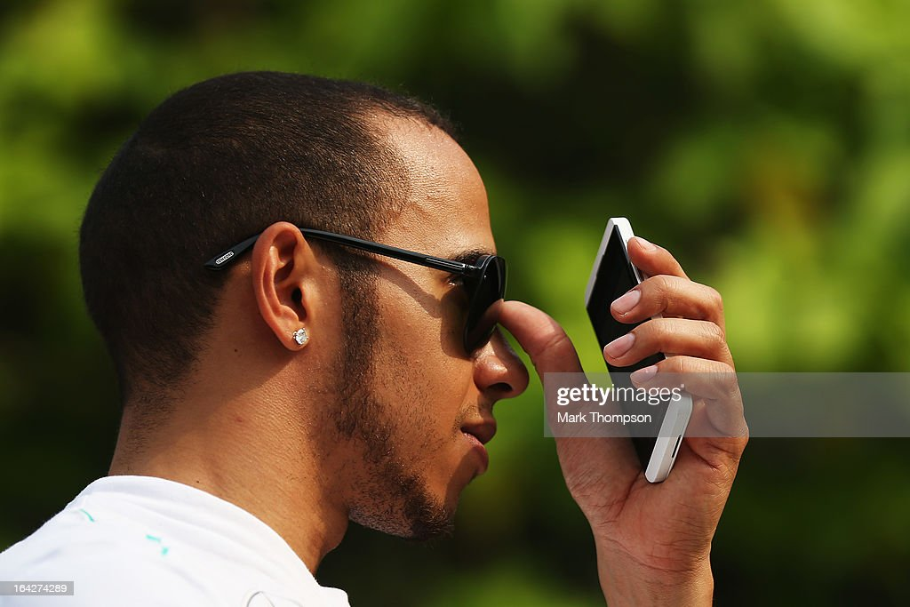 <a gi-track='captionPersonalityLinkClicked' href=/galleries/search?phrase=Lewis+Hamilton+-+Racecar+Driver&family=editorial&specificpeople=586983 ng-click='$event.stopPropagation()'>Lewis Hamilton</a> of Great Britain and Mercedes GP walks in the paddock following practice for the Malaysian Formula One Grand Prix at the Sepang Circuit on March 22, 2013 in Kuala Lumpur, Malaysia.