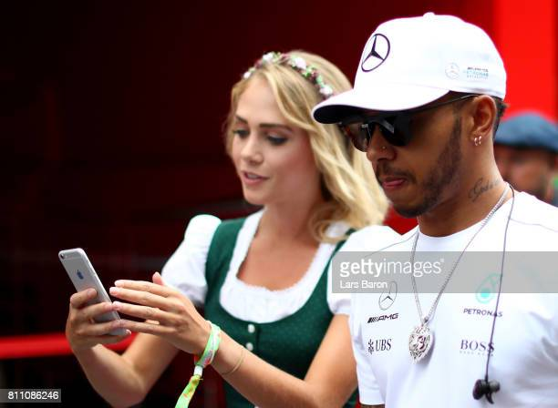 Lewis Hamilton of Great Britain and Mercedes GP walks in the Paddock before the Formula One Grand Prix of Austria at Red Bull Ring on July 9 2017 in...