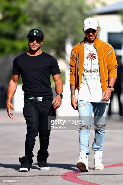 Lewis Hamilton of Great Britain and Mercedes GP walks in the Paddock with brother Nicholas during previews ahead of the United States Formula One...