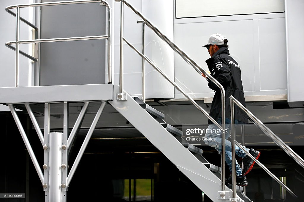 Lewis Hamilton of Great Britain and Mercedes GP walks into a Mercedes truck in the Paddock before practice for the Formula One Grand Prix of Austria at Red Bull Ring on July 1, 2016 in Spielberg, Austria.