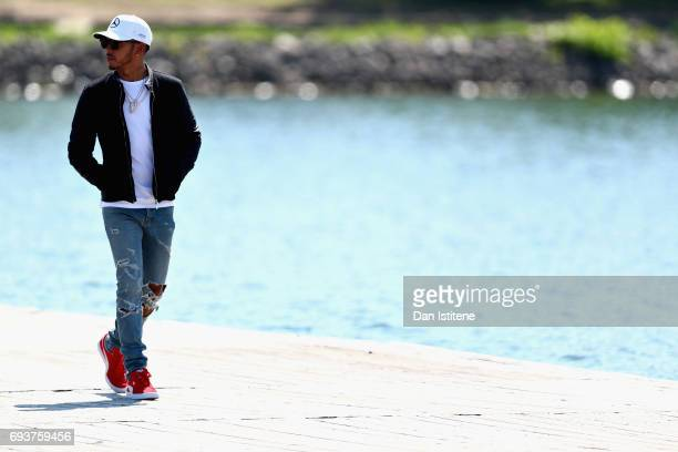 Lewis Hamilton of Great Britain and Mercedes GP walks into the paddockduring previews for the Canadian Formula One Grand Prix at Circuit Gilles...