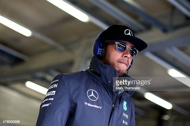 Lewis Hamilton of Great Britain and Mercedes GP walks out for the drivers' parade before the Formula One Grand Prix of Austria at Red Bull Ring on...