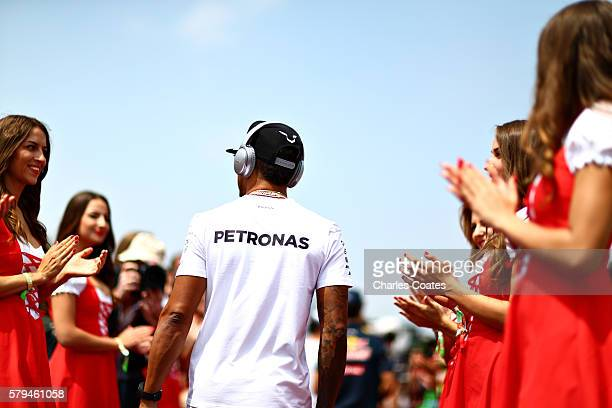 Lewis Hamilton of Great Britain and Mercedes GP walks to the drivers parade before the Formula One Grand Prix of Hungary at Hungaroring on July 24...