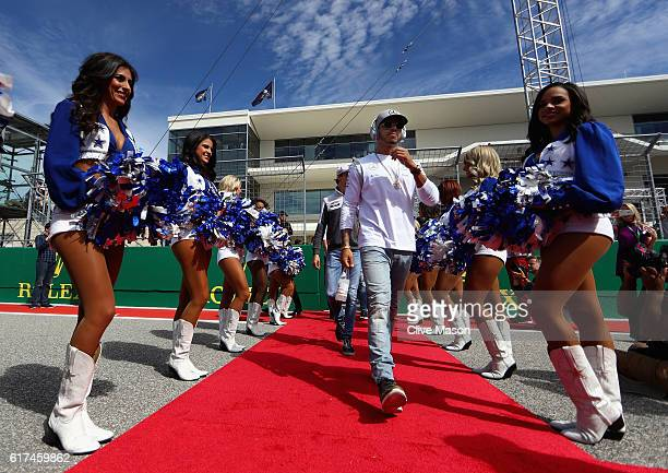 Lewis Hamilton of Great Britain and Mercedes GP walks to the drivers parade before the United States Formula One Grand Prix at Circuit of The...