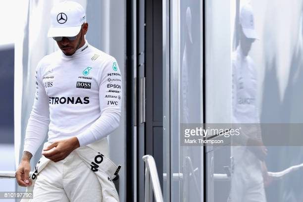 Lewis Hamilton of Great Britain and Mercedes GP walks to the garage during practice for the Formula One Grand Prix of Austria at Red Bull Ring on...