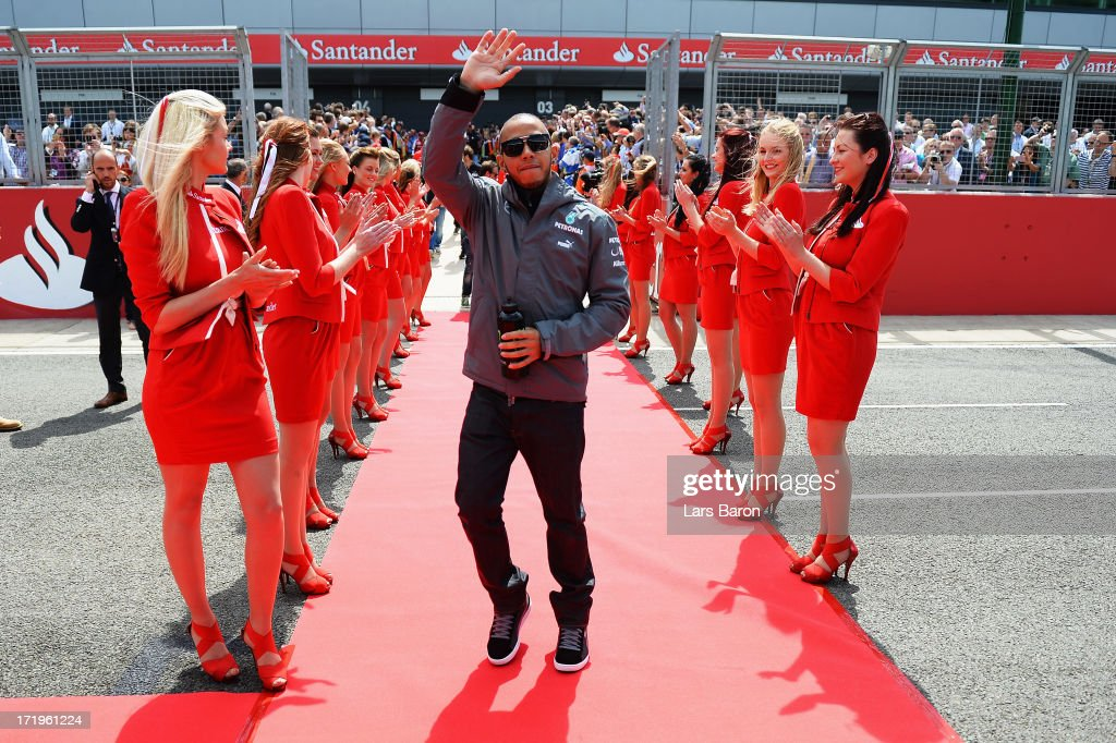 Lewis Hamilton of Great Britain and Mercedes GP waves to fans before the British Formula One Grand Prix at Silverstone Circuit on June 30, 2013 in Northampton, England.