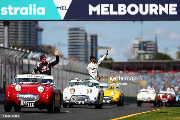 Lewis Hamilton of Great Britain and Mercedes GP waves to the crowd on the drivers parade ahead of the Australian Formula One Grand Prix at Albert...