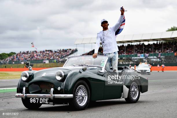 Lewis Hamilton of Great Britain and Mercedes GP waves to the crowd on the drivers parade before the Formula One Grand Prix of Great Britain at...