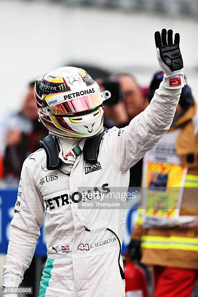 Lewis Hamilton of Great Britain and Mercedes GP waves to the crowd after getting pole position during qualifying for the Australian Formula One Grand...