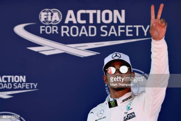Lewis Hamilton of Great Britain and Mercedes GP waves to the crowd after qualifying in pole position during qualifying for the Spanish Formula One...