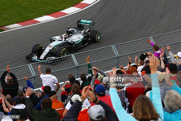 Lewis Hamilton of Great Britain and Mercedes GP waves to the fans during practice for the Canadian Formula One Grand Prix at Circuit Gilles...
