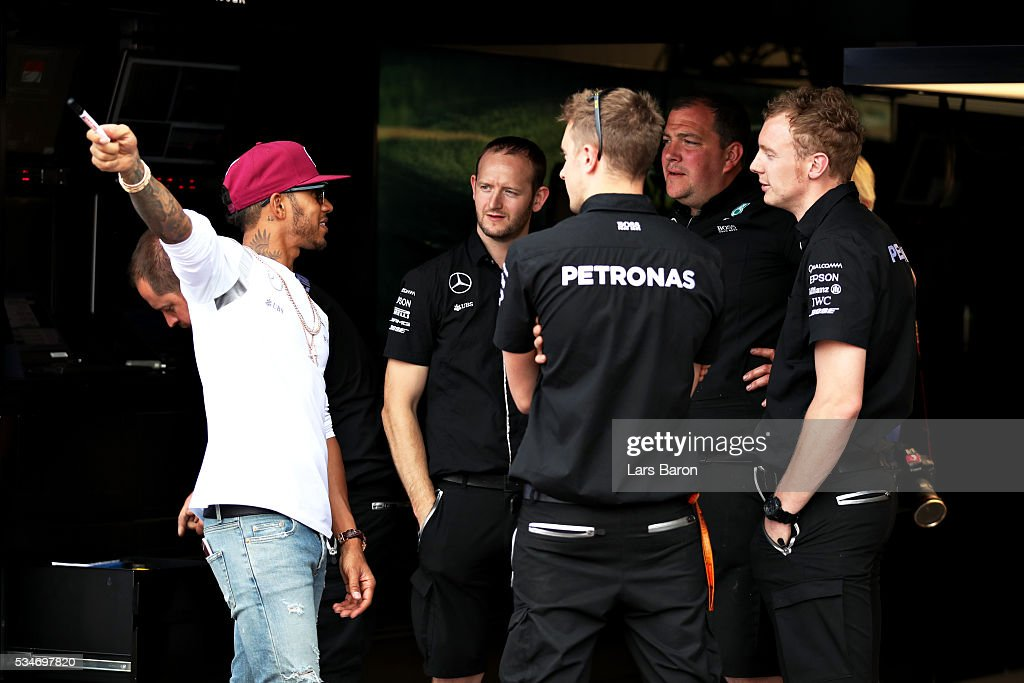 <a gi-track='captionPersonalityLinkClicked' href=/galleries/search?phrase=Lewis+Hamilton&family=editorial&specificpeople=586983 ng-click='$event.stopPropagation()'>Lewis Hamilton</a> of Great Britain and Mercedes GP with the Mercedes GP team in the garage during previews to the Monaco Formula One Grand Prix at Circuit de Monaco on May 27, 2016 in Monte-Carlo, Monaco.