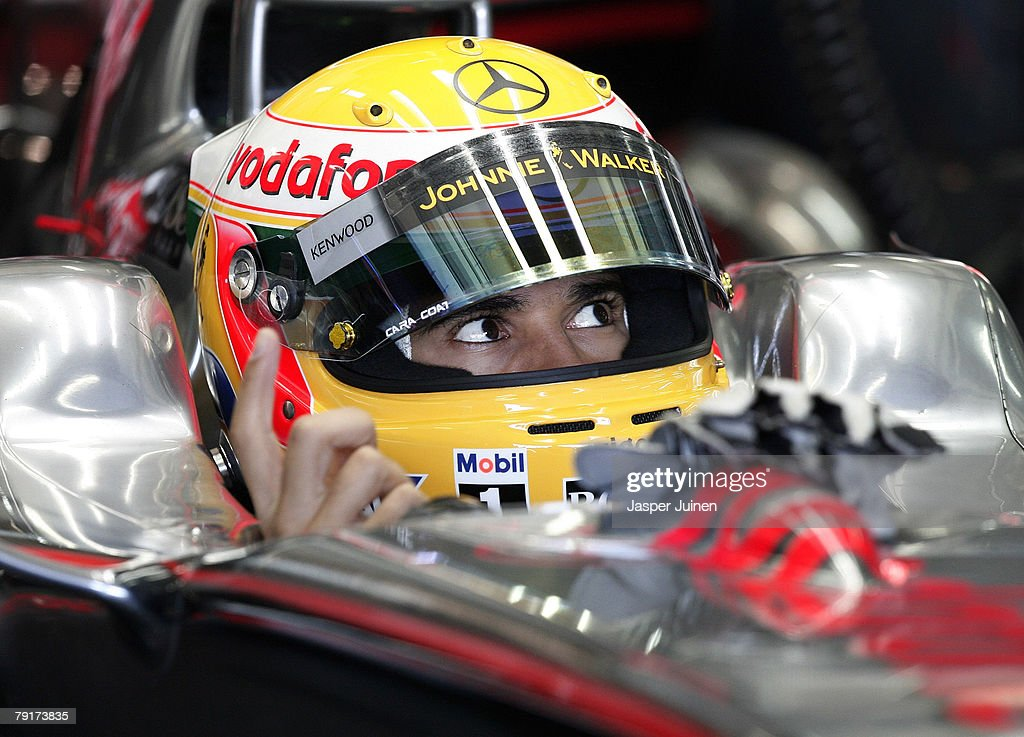 Lewis Hamilton of Great Britain and team McLaren Mercedes gestures to mechanics during Formula one testing at the Ricardo Tormo racetrack on January 23, 2008, in Cheste near Valencia, Spain.